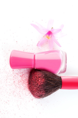 Beauty accessories  Nail polish and makeup brush with powder isolated on white background, top view  Feminine cosmetics concept  photo