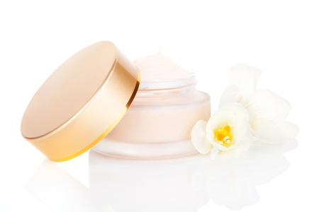 Luxurious cosmetic background  Cream in jar with blossom isolated on white background  Feminine skin care concept  Stock Photo