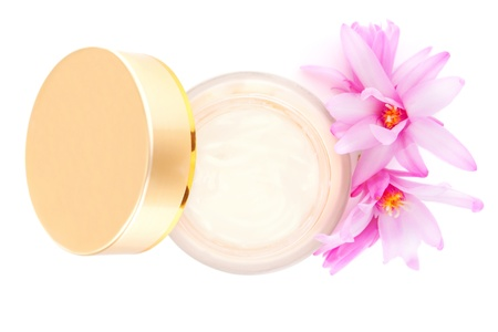 Cosmetic cream with blossom, top view isolated on white background  Luxurious cosmetics and makeup concept  photo