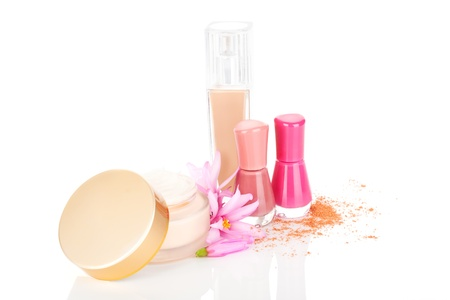Luxurious glamour cosmetic background  Beige foundation, red and pink nail polish and lotion with blossom isolated on white background with reflection  Stock Photo - 18836048