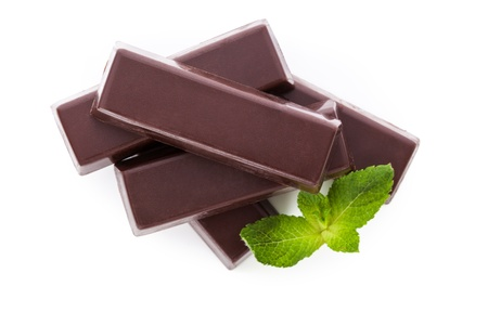 Delicious dark brown chocolate bar with mint leaves isolated on white background  Culinary dessert eating  photo
