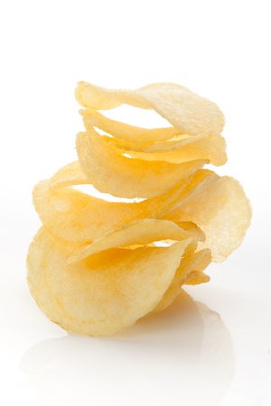 junk food: Crispy crisps stack isolated on white background. Unhealthy junk food eating concept.