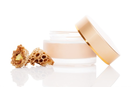 beeswax: Luxurious beeswax cosmetic background  Cream in jar and natural royal jelly isolated on white background  Feminine skin care concept  Stock Photo