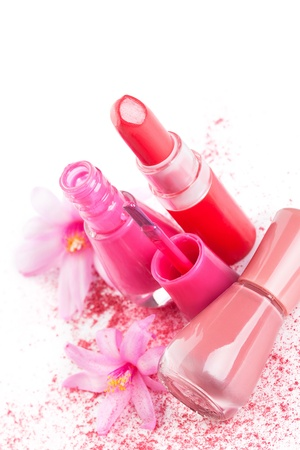 Pink and beige lipstick and nail polish with pink facial powder and flower isolated on white background  Girly make up and cosmetics still life  Stock Photo - 20101642