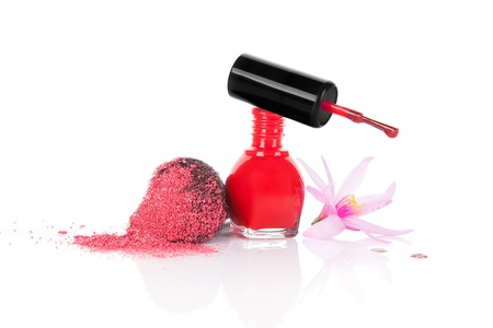 Red nail polish and make up brush with pink facial powder isolated on white background with pink blossom  Girly glamour make up and cosmetic background Stock Photo - 20096038