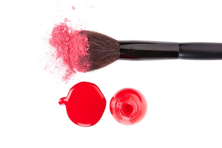 Make up brush with pink facial powder and red nail polish and splatter isolated on white background, top view with clipping path  Feminine make up and cosmetics still life Stock Photo - 20101656