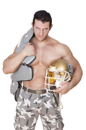 Big shirtless sexy football player with protection and helmet angry looking into the camera isolated on white background. Sport and Fitness concept. photo