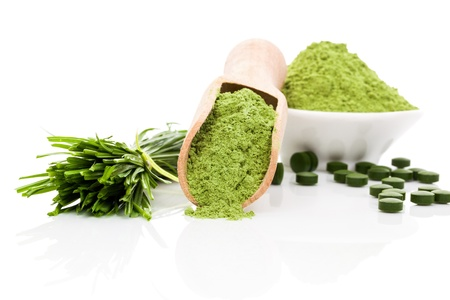 Spirulina; chlorella and wheatgrass. Green food supplement. Green pills; wheatgrass blades and ground powder isolated on white background. Healthy lifestyle. photo