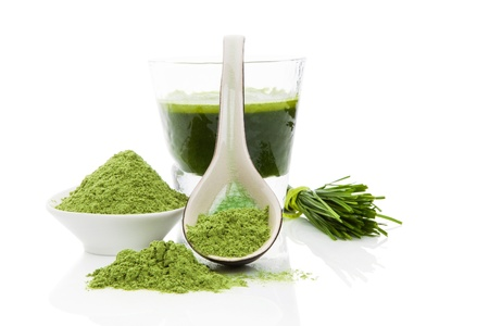 Green food supplement. Wheatgrass blades, green ground powder and green drink isolated on white background. Healthy lifestyle. Stock Photo