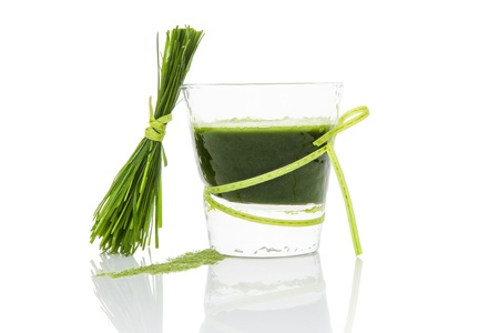 Green wheat grass juice, barley grass blades and ground powder isolated on white background  Natural herbal medicine, living healthy  photo