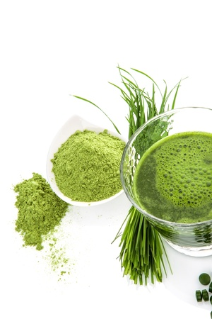 Green natural superfood  Detox  Healthy living  Wheatgrass, chlorella spirulina  Ground powder, pills, green juice and blades  photo