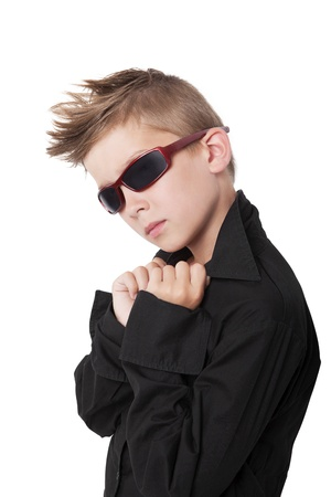 cool boy: Confident cool boy with black dress shirt and sunglasses isolated on white background.