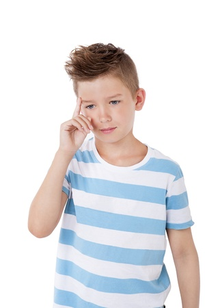 Charming young boy with cool haircut touching eyebrows and thinking isolated on white background. photo