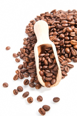 Coffee beans with wooden scoop isolated on white background. Traditional coffee background. photo
