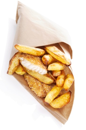 chips: Delicious golden fish and chips in brow bag. Traditional english eating. Unhealthy fast and junk food.