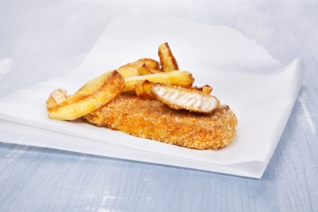 Fish and chips on blue wooden background. Delicious seafood background.  photo