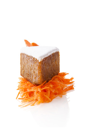 carrot cake: Delicious carrot cake on grated carrots isolated on white background. Culinary sweet dessert.