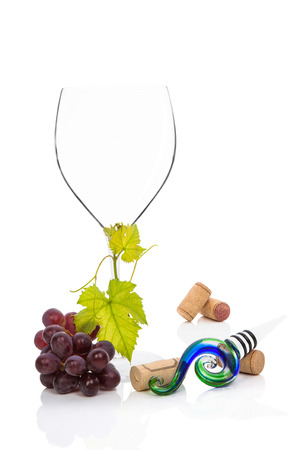 cabernet sauvignon: Wine glass, with cabernet sauvignon grapes, vine leaves wine stopper and wine corks isolated on white background. Culinary gourmet red wine drinking.