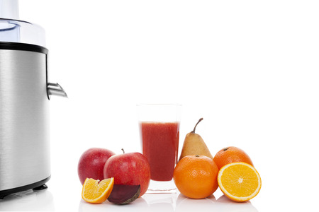 Multivitamin juice. Juicing background with copy space. Fresh apples, oranges, glass with juice and silver juicer isolated on white background. Healthy fruit eating and drinking. Stock Photo - 24471702