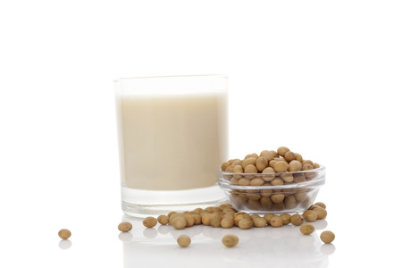 sudio: Soya milk in glass with soya beans isolated on white. Vegan milk concept.