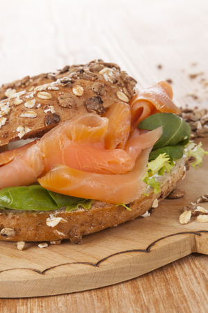 Salmon bagel detail with fresh salmon. Healthy american eating.  photo