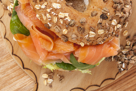 Delicious bagel eating. Fresh baked bagel with smoked salmon top view. American eating.  photo