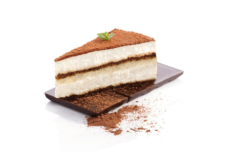 Tiramisu dessert on chocolate bar isolated on white background. Italian sweet dessert concept. Stock Photo