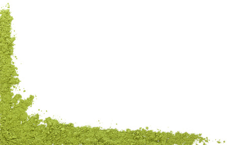 Detox background with copy space. Wheat grass powder isolated on white background, top view with space for your text. Green superfood. photo