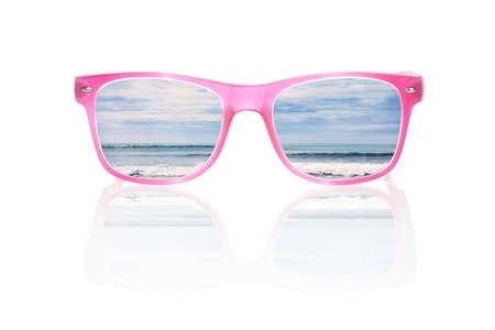sunglasses reflection: Tropical ocean in pink sunglasses isolated on white background, with reflection. Summer vacation and holiday concept.