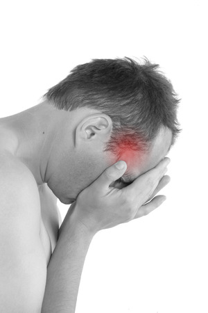 Headache and migraine. Young man touching his head isolated on white background. Pain concept.  photo