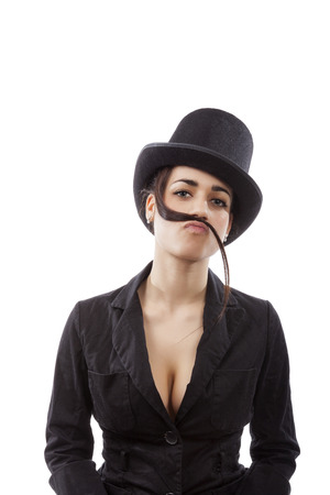 Beautiful young girl with cylinder hat and black dress with mustache from hair. Female discrimination in workplace. photo