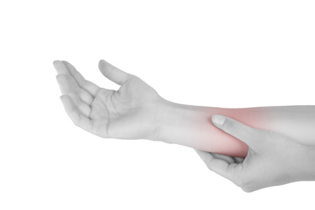 muscle strain: Forearm muscle strain. Female hand touching forearm isolated on white background.