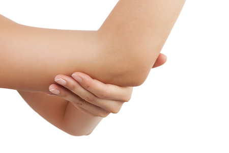 female hand: Elbow pain. Beautiful female holding her elbow. Pain concept. Stock Photo