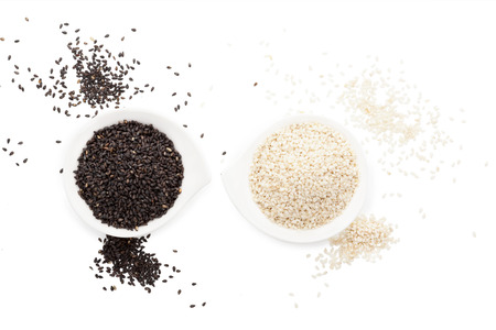 white sesame seeds: Black and white sesame seeds isolated on white background top view with clipping path. Stock Photo