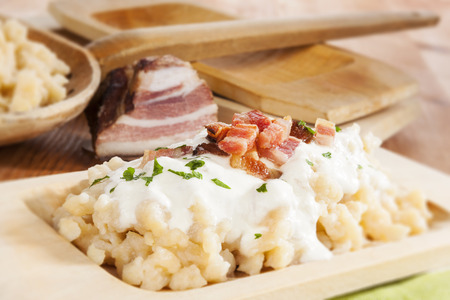 Bryndzove halusky. Potato dumplings with bryndza sheep cheese and bacon. Bryndzove halusky, traditional national slovak food.