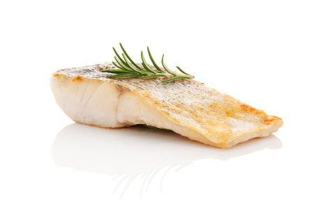 Luxurious seafood dinner. Perch fish fillet isolated on white background with fresh green herbs. Healthy eating. Stockfoto