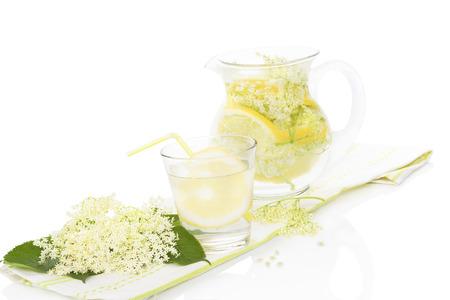 Elderberry lemonade with fresh lemon and lime and elderberry blossom isolated on white background. Fresh summer healthy drink Stock Photo