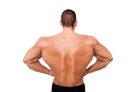 steroids: Huge bodybuilder back on steroids. Bodybuilder posing isolated on white background.