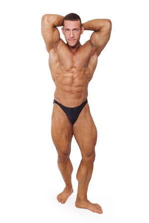 sexy pose: Sexy shirtless muscular bodybuilder posing isolated on white background. Sports and fitness.