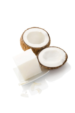 coconut oil: Organic hard coconut oil on plated with coconut isolated on white background. Healthy eating and cooking.