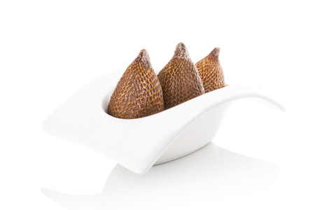 salak: Salak fruit in bowl isolated on white background. Tropical fruit, asian cooking and eating.