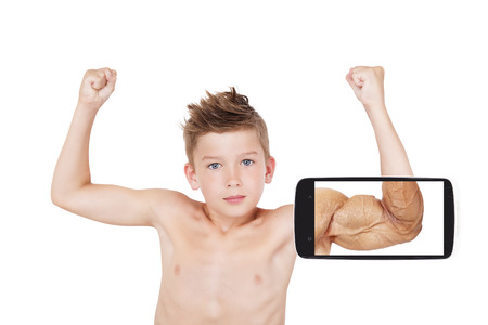 self confidence: Vision of success. Charming boy showing muscle with future vision on smartphone screen. Seeing the future, self confidence and self perception. Stock Photo