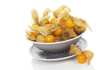 husk tomato: Physalis, groundcherries in bowl isolated on white background Stock Photo