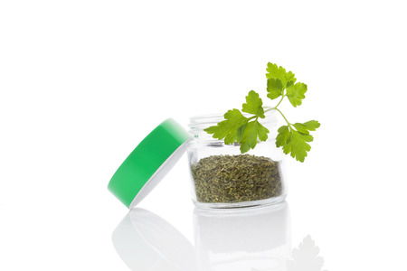 glass jar: Fresh parsley leaf and dry parsley spice in glass jar isolated on white background Stock Photo