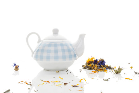 herbs white background: Delicious herbal tea mix with teapot isolated on white background