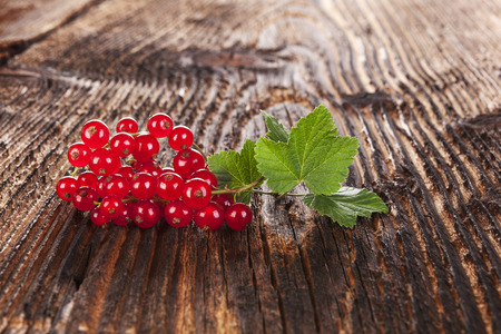red currant: Ripe red currant on old vintage wooden background Stock Photo