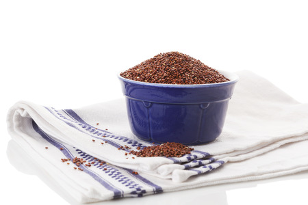 red quinoa: Red quinoa seeds in bowl isolated on white background