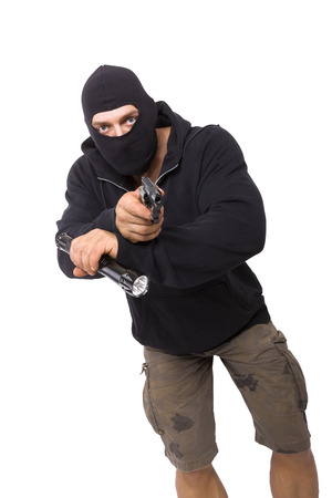 danger: Man in black mask and black cloth holding flashlight and gun isolated on white background