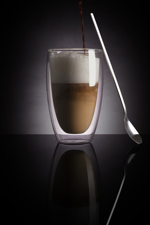 Caffe latte on dark background.