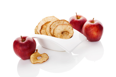 healthy snack: Dry and fresh apples isolated on white background. Healthy snack eating.